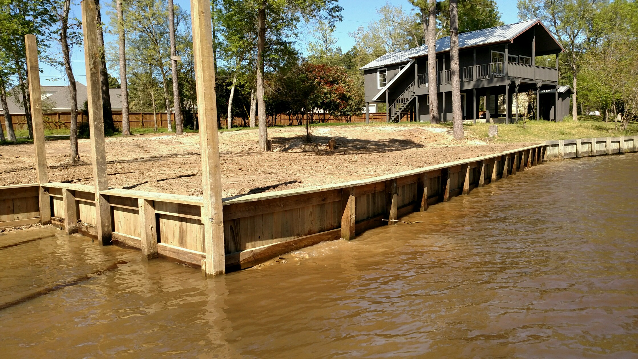 After bulkhead construction and boat slip near huffman on lake houston