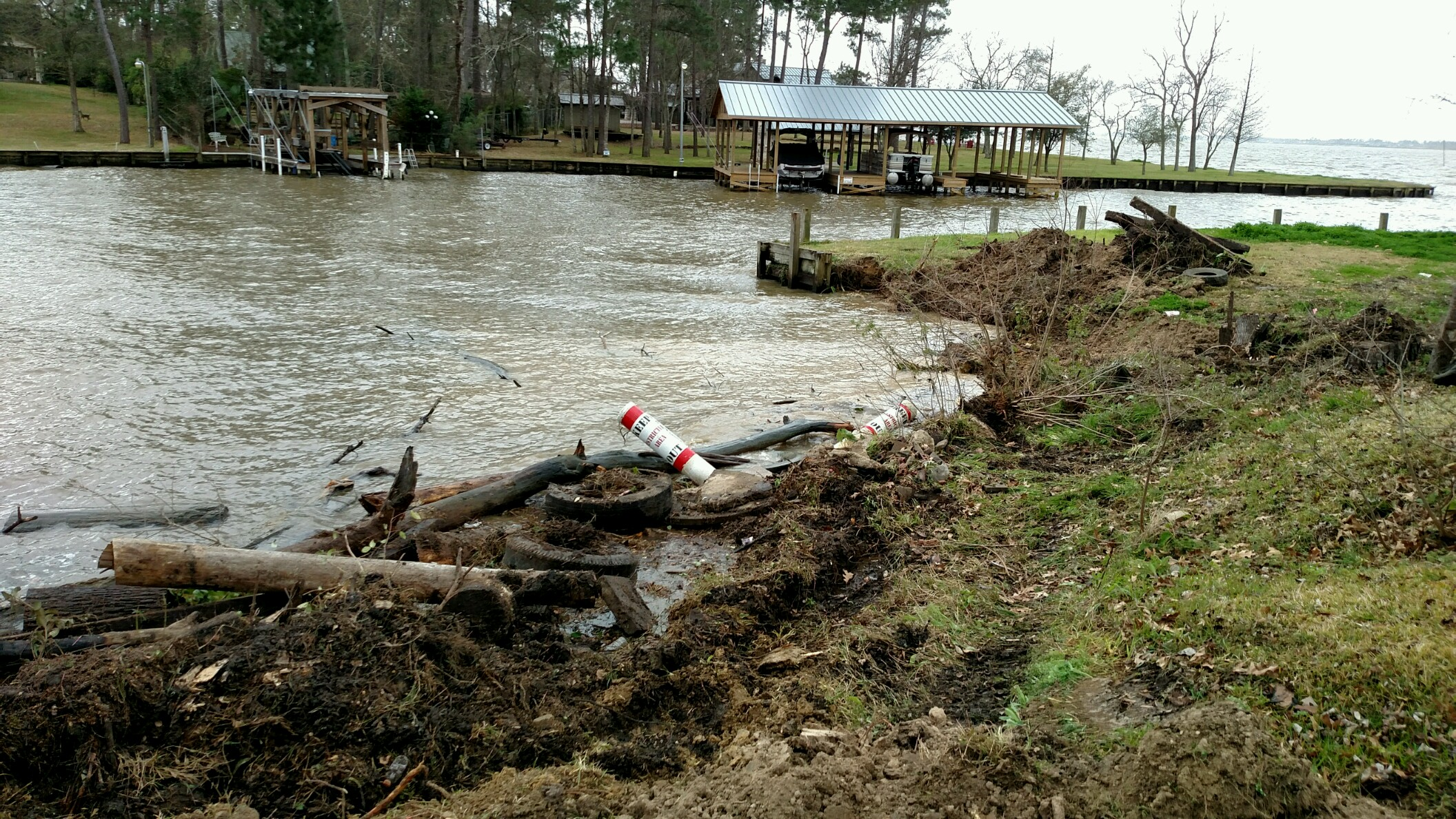 Debris on bank before bulkhead construction in crosby on lake houston