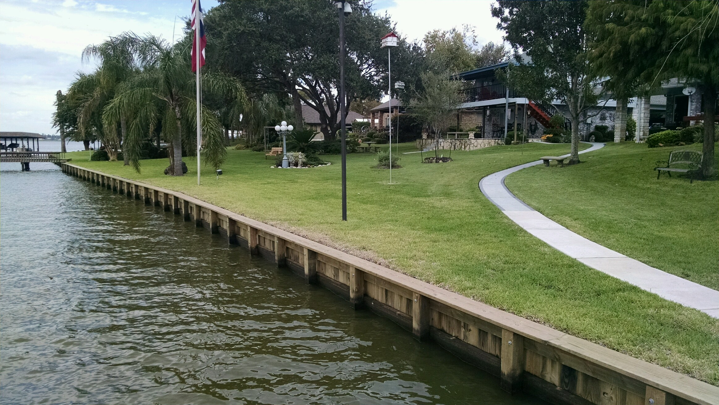After sod and bulkhead construction on lake houston