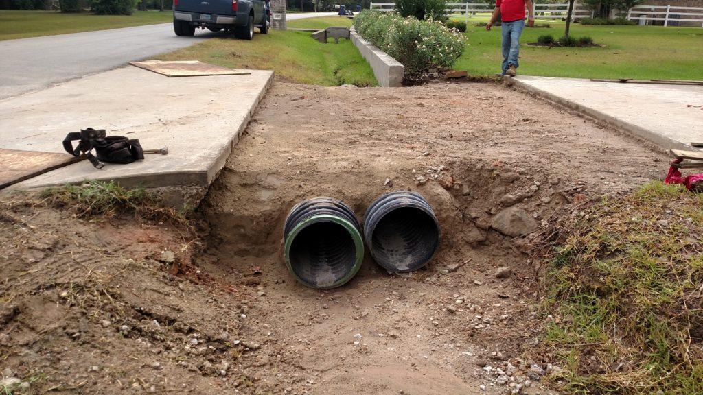 concrete and demolition driveway pour twin culverts