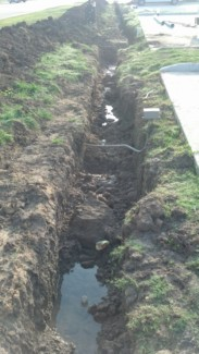 trenching that caved in due to heavy rain