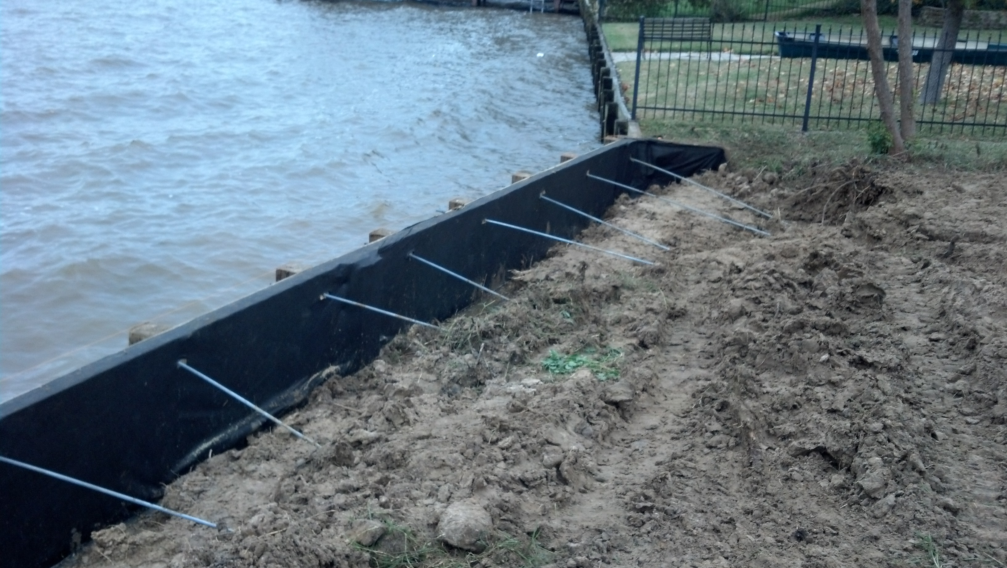 tie rods installed behind new bulkhead construction on lake houston