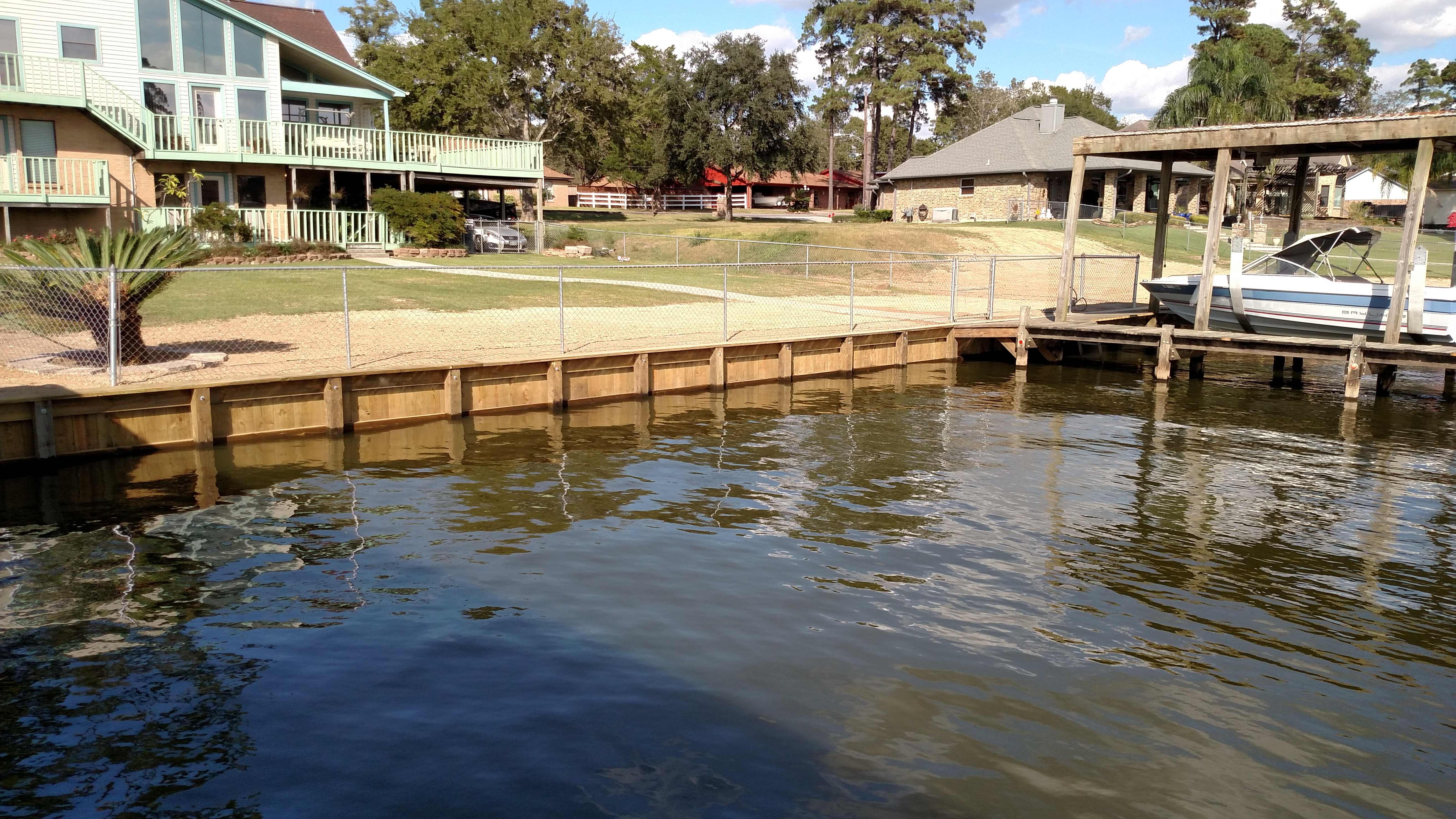 Concrete wall replaced by wooden bulkhead construction on lake houston