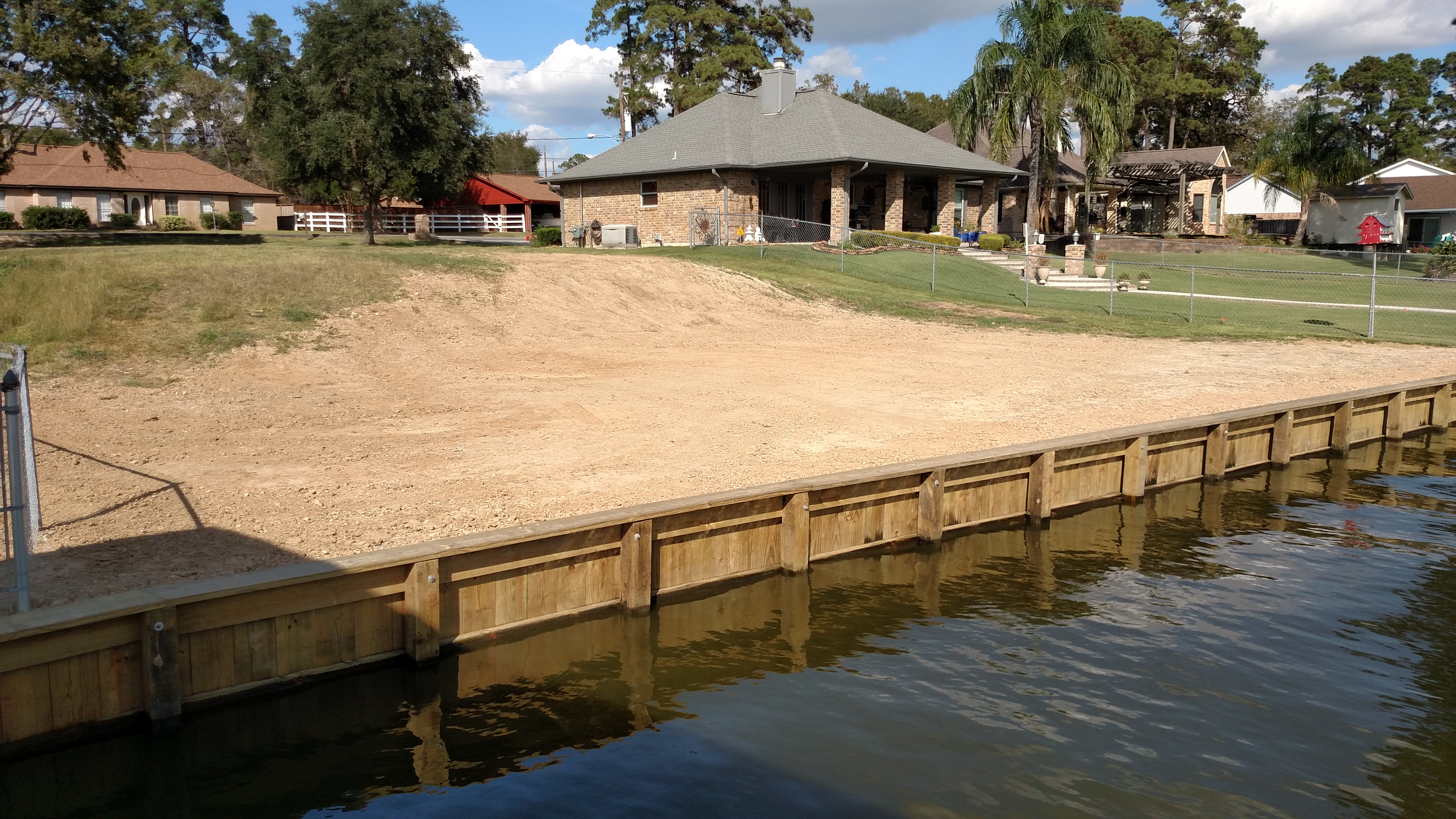 After replacement bulkhead construction and grading on lake houston