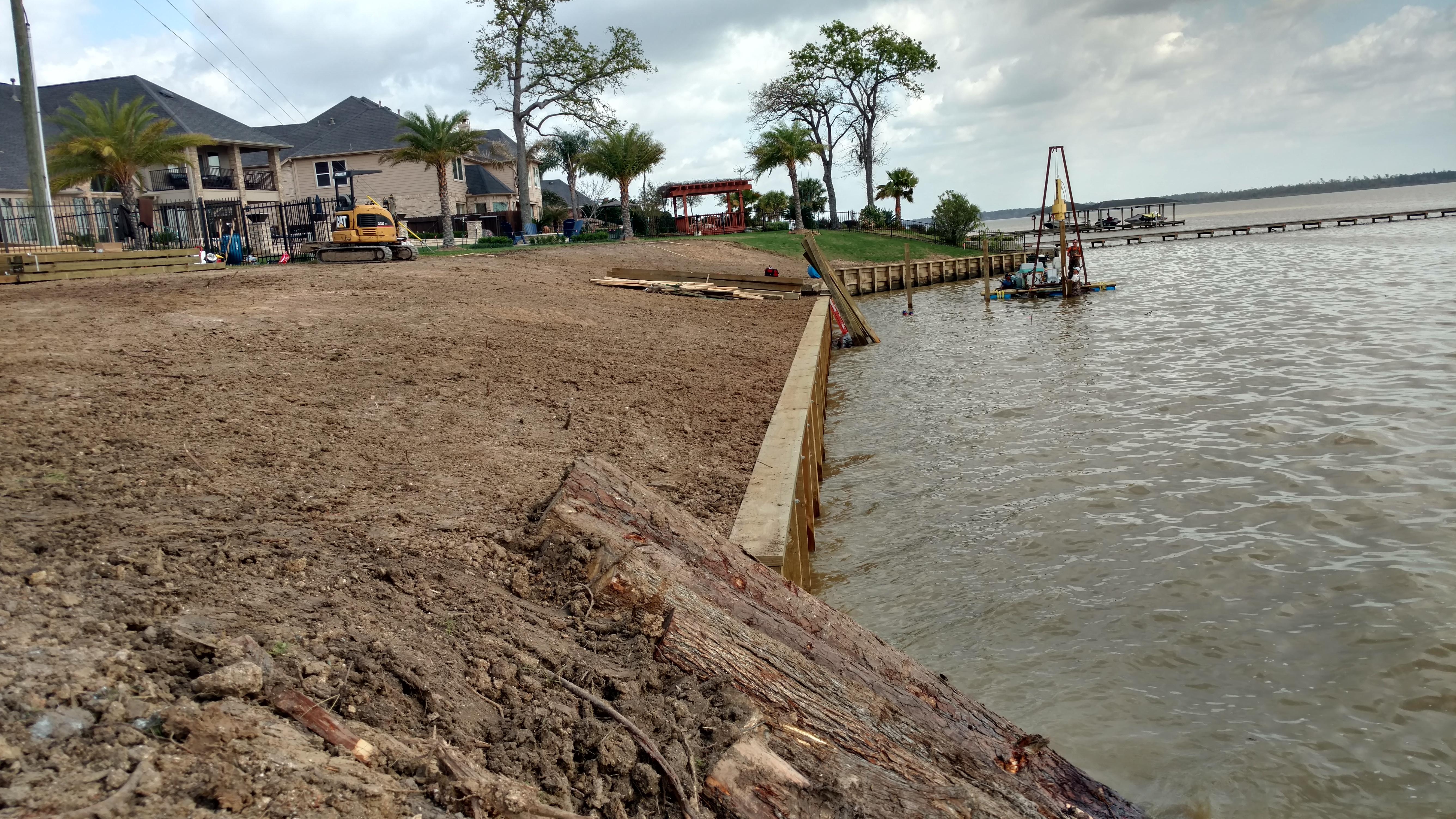 wood bulkhead construction and grading on lake houston